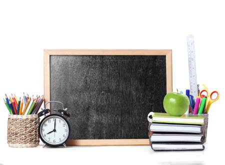 utiles escolares: Libros y pizarra de la escuela suministra Volver a la escuela. Foto de archivo
