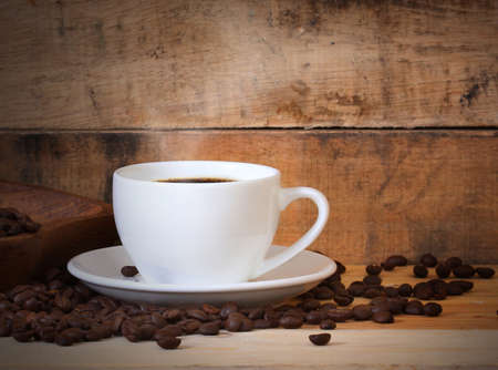 cup of coffee white cup on wooden background  photo
