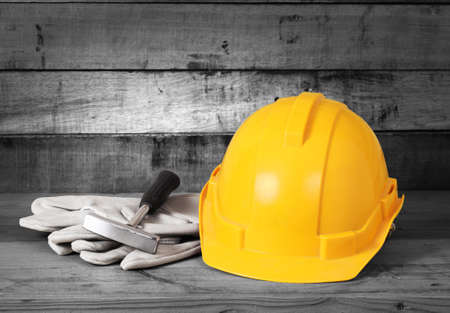 Yellow hardhat and old leather gloves Stock Photo - 17746695