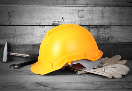white glove: Yellow hardhat and old leather gloves  Stock Photo