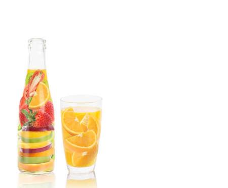 fruit juice vitamin bottle isolated on white  photo