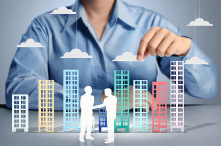 Building in a hand businessmen Stock Photo - 18254532