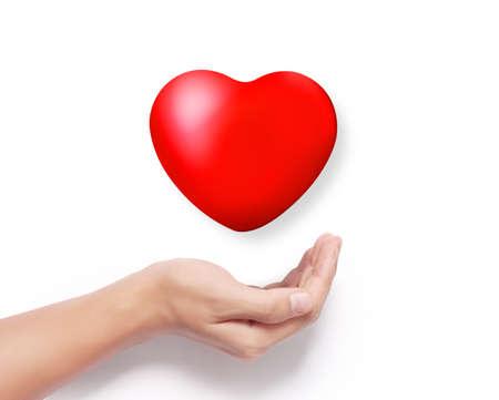 cuore nel le mani: Cuore rosso in una mano isolata Archivio Fotografico