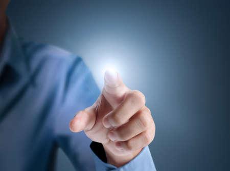 タッチ スクリーンのボタンを押すとビジネス男 写真素材