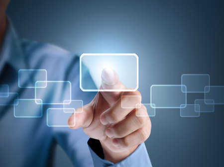 Business man pressing a touchscreen button  Stock Photo