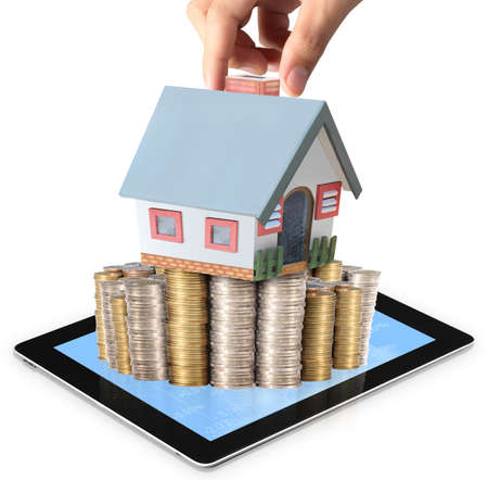 businessmen Protect Your House in hand and shows tablet