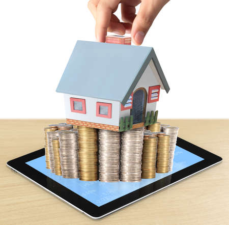 partment: businessmen Protect Your House in hand and shows tablet