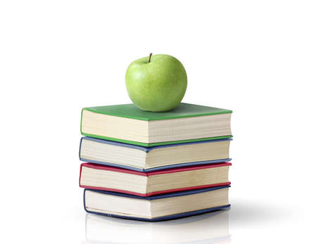 apple on books White background photo