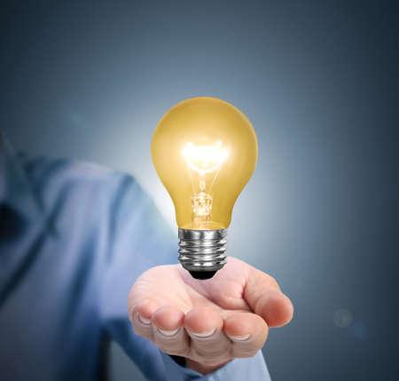 手のアイデア電球 写真素材