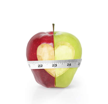 measured: Green apples measured the meter on a white