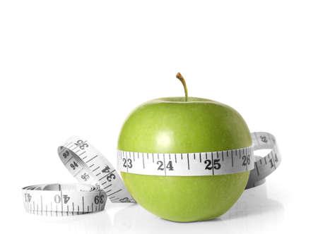 verde manzana: Manzanas verdes mide el metro en un blanco