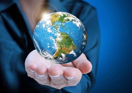 earth in human hand  photo