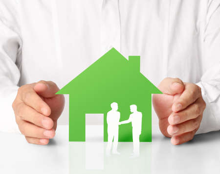 model home: house of paper in hand businessmen  Stock Photo