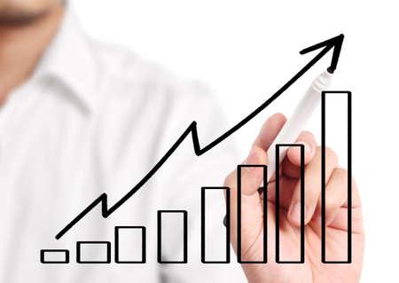 market share: Business man drawing a graph