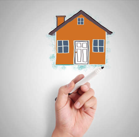 businessmen drawing the house  photo