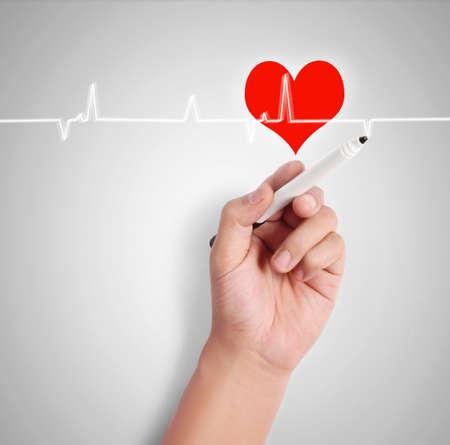 drawing heart symbol at interactive whiteboard  photo