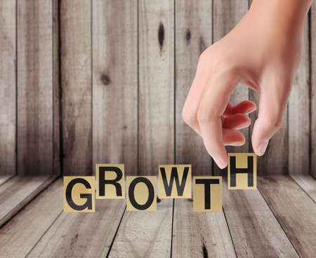 Hand and word growth on a wood background  photo