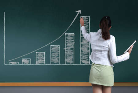 Business chart  growth on a blackboard photo