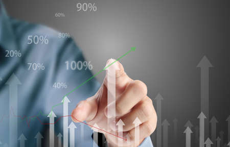 growth in economy: Business man pushing the graph  Stock Photo