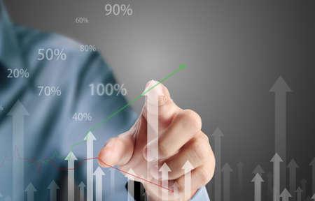 Business man pushing the graph  Standard-Bild