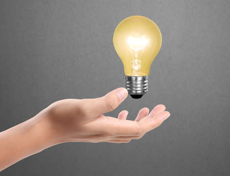 Ideas bulb light on a hand  photo