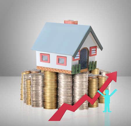 硬貨からのお金の家を住宅ローンの概念