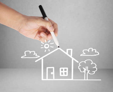 business men drawing the house  photo