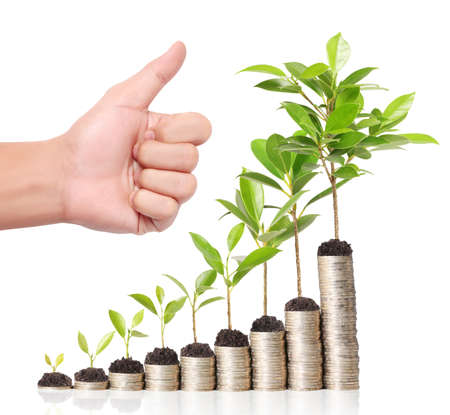 grow: Businessman holding plant sprouting from a handful of coins  Stock Photo