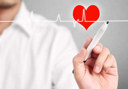 man drawing the chart heartbeat Stock Photo - 23569671