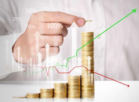 Hand put coin to money ,Business idea  Standard-Bild