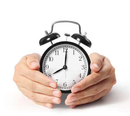 hands  hour: man holding alarm clock in the hands  Stock Photo