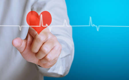 Medicine doctor working pushing heart Stock Photo