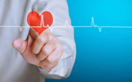 Medicine doctor working pushing heart Stock Photo