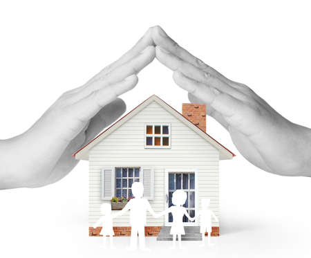 building insurance: holding house representing home ownership and the Real Estate business
