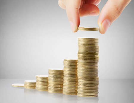cash in hand: Hand put coin to money ,Business idea  Stock Photo