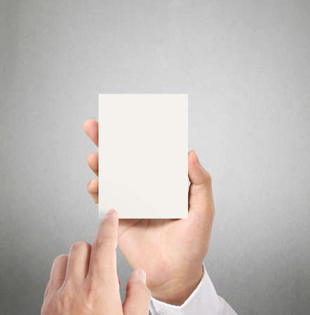 handing over: handing a blank business  card over in hand  Stock Photo