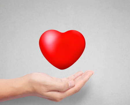 massage symbol: Heart in the hands isolated