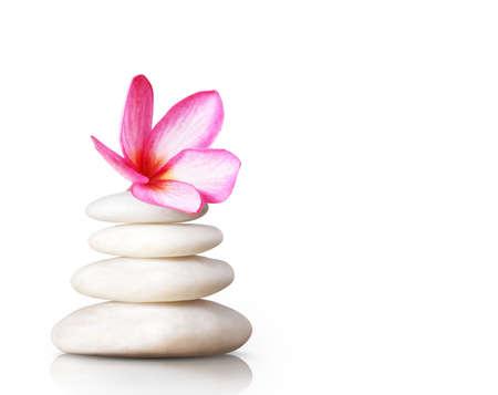 peacefulness: spa concept massage stones with frangipani plumeria flower