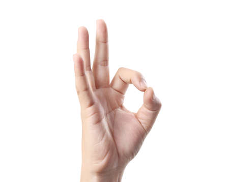 positivity: hand in ok sign on a white isolated background