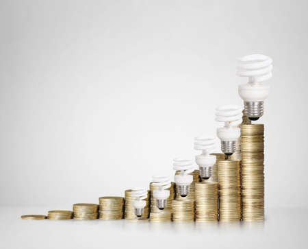 Money saved in different kinds of alight bulbs photo