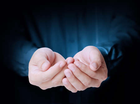 cupped hands: Open palm a hand gesture  Stock Photo
