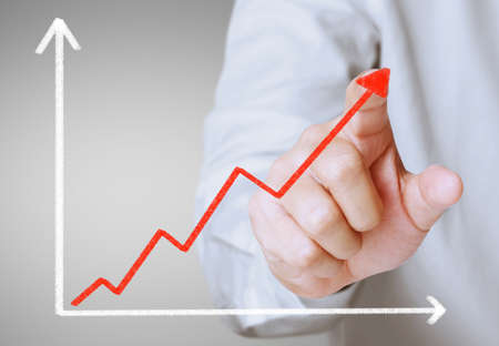 secure growth: Business man pushing the graph  Stock Photo