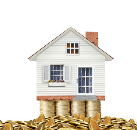 Mortgage concept by money house from the coins  photo