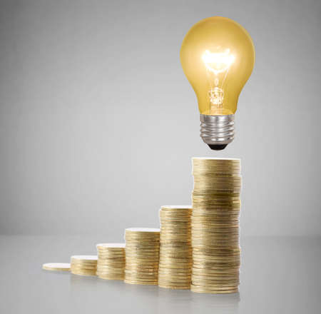 Money saved in different kinds of a light bulbs  photo