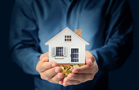 mortgage: holding house representing home ownership and the Real Estate business