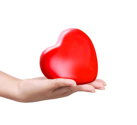 doctor holding gift: close up red heart in womans hand
