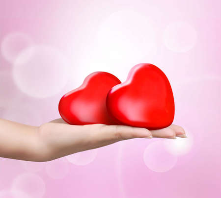 close up red heart in womans hand photo