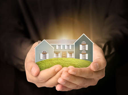 concept image, the house in human hands