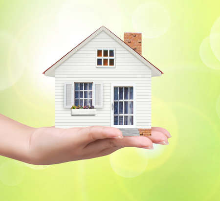 begin for mortgage concept, holding a house  photo
