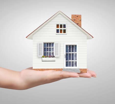 economic rent: begin for mortgage concept, holding a house  Stock Photo